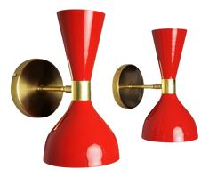 The Ludo wall sconce or reading light shown in unlacquered brass and electric high-gloss red enamel fabricated in NYC by Blueprint Lighting, 2017. The spun aluminium cones are a vintage 1950s Italian design. Swiveling head allows for cone adjustment. This design is strongly influenced by both French and Italian mid-century modernism. In the style of Stilnovo. This piece may be hardwired for use with a light switch (as shown), hardwired but with a toggle switch on the backplate for manual…