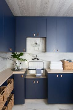 sleek navy cabinets in the laundry room