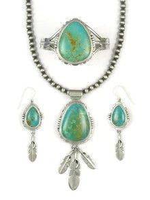 Manassa turquoise necklace, earring and bracelet set featuring silver feathers by Native American artist, John Nelson.