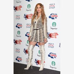 Snakeskin Boots:         Jennifer Lopez, actress and singer, mixes things up a bit with her pale-colored, thigh-high, stiletto-heeled boots. The white tone adds an element of surprise to her ensemble and keeps her looking fresh and fashion-forward. Try yours in a pale gray or camel and pair them with a short dress or skirt to show them off.