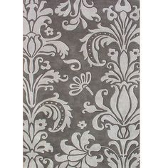 $382 8' X 10' This Metro Floral rug features hand-tufted wool construction and a plush 0.5-inch pile. This rug also features a modern floral pattern with accents of light and dark grey.     Primary materials: Wool  Pile height: 0.50 inches  Style: Contemporary  Primary color: Grey  Pattern: Floral