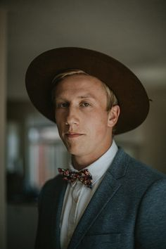 Add more flair than a bow tie or boutonniere can w/ this felt hat trend | Image by The Toths Photo & Film