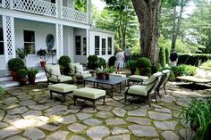 Why fight with trying to grow grass under a tree?  Make a moss and stone patio instead.