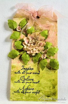 Elegant looking---Use Tim Holtz Tattered Floral die for the flower and Glimmer Mist for the colors!
