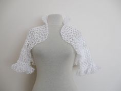 Bridal crochet shrug in white by innovation and design, via Flickr