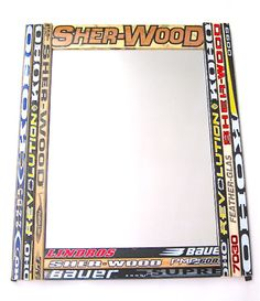 """Perfect for the hockey fan. We gather broken hockey sticks and create a colorful, fun and functional mirror. One-of-a-kind piece that looks great wherever it hangs out. Large and small formats available. Mirror pictured is 26"""" X 32"""""""