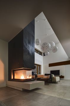 Buy Interior in a modern style by bezikus on PhotoDune. Hall in a cottage with light walls and big round decorative lamps at the top. In the front there is a glass fireplace. Fireplace Doors, Home Fireplace, Modern Fireplace, Fireplace Design, Fireplace Glass, Home Room Design, Home Interior Design, House Design, Indoor Outdoor Fireplaces