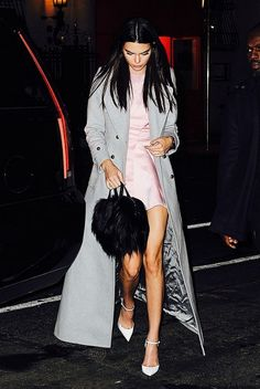 Kendall Jenner wears a gray cashmere trench coat over a pink satin dress with Christian Louboutin ankle-strap pumps and a Givenchy shoulder bag