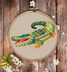 This is modern cross-stitch pattern of Mandala Crocodile for instant download. You will get 7-pages PDF file, which includes: - main picture for your reference; - colorful scheme for cross-stitch; - list of DMC thread colors (instruction and key section); - list of calculated