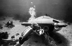 """French explorer and oceanographer Jacques-Yves Cousteau near his """"diving saucer"""" during an undersea exploration in the Red Sea, in June of 1963 Jacques Cousteau, Diving World, Sea Diving, Paris France, 50 Years Ago, Beneath The Surface, Underwater Life, The Weather Channel, History Photos"""