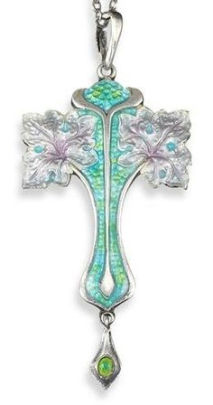 An Art Nouveau silver and enamel pendant, of foliate cross form and with conforming pendant, on fine link silver chain. Attributed to Schaverien & Eastmead.