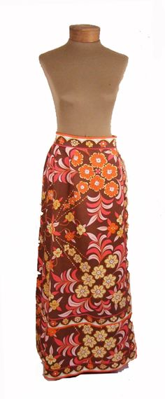 WHAT WE LOVE:    - VINTAGE MAXI SKIRT    - 1960'S RETO PRINT        DESCRIPTION:    So chic worn high on the waist with a tucked in top. Vintage long maxi length pucci skirt, which used to be called a hostess skirt. A line shape. Heavy weight cotton. Fun brown, orange, coral, yellow, light pink and white geometric floral print. Emilio written through out.  Signature Pucci trim  on waistband, down front and around...