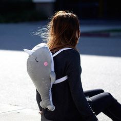 Get this backpack that doubles as a snuggle pal.   25 Gifts For People Obsessed With The Ocean