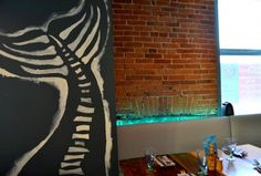 Chalk like murals of fish done by local student artist at Dianne's in Kingston!