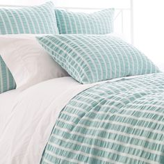 Classic coastal style has never been more effortless than with this cotton duvet, featuring sky blue stripes and the textural appeal of gentle smocking. Combine with any of our C3 bedding or accessories, including bath towels, storage bins, and cozy throws.  • 100% cotton.  • Knife edge.  • Hidden button closure.