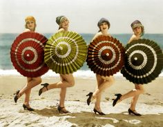 the-edwardian-lady:    1920's flappers, with parasols on the beach.