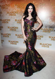 We love this gown! Lily Collins looked gorgeous at the Paris premiere of her new Snow White film, 'Mirror Mirror'