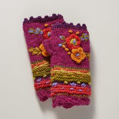 """POSIE HANDWARMERS--Our fleece-lined floral wool handwarmers add a happy note to your winter ensemble with brightly blooming flowers in a celebration of color and pattern. Fleece lined. Wool. Hand wash. Imported. One size fits most adults. Approx. 8""""L."""