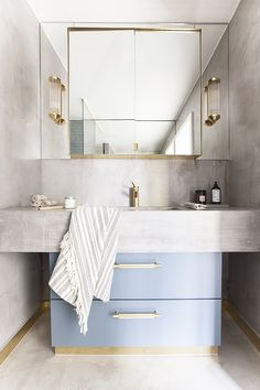 My bathroom. A mix of concrete, gold hardware and St. Pauls Blue fromjotun. The Sink cabinet is an IKEA hack that we have painted and the handles are from Buster&Punch. The listing is from Superfront and the tap in brass is from Tapwell. Photo: Mint Agency