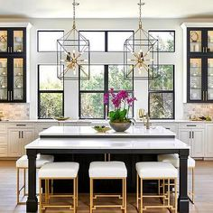 Dual Black Kitchen Islands with White and Gold Stools