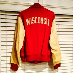 Vintage Wisconsin Letterman Jacket Here's a rare vintage varsity jacket also called a bomber jacket. From Wisconsin university - home of the Badgers I believe! I bought it a while back because it reminded me of JJ Watt .... He's a big deal here in Houston, Texas ;) Its red cotton material and cream leather. Genuine leather and in excellent vintage condition! Comes from a smoke-free and pet-free home. Vintage Jackets & Coats