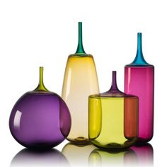 colorful hand blown glass bottles, goblets and decor. contemporary glass statement pieces, handcrafted by michael schunke and josie gluck. Glass Vessel, Glass Ceramic, Glass Art, Elements Of Design Shape, Glass Photography, Rainbow Glass, Through The Looking Glass, Glass Collection, Glass Design