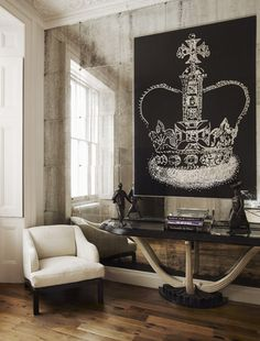 Love the mirrored wall and the crown artwork. Photography by Mel Yates.