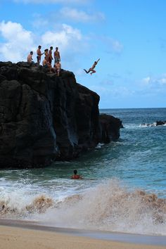 Waimea Bay, North Shore, Oahu, Hawaii. Cliff/rock jumping