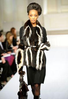 Oscar De La Renta.... Skunalicious, this will match my skunk boots!!! :)