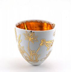 """See my scales where my feathers used to be"": Vessel,10cmx10.5cm8.5cm, porcelain, clear glaze, lustre, gold, sand etched, enamel by Joanna Demaine."