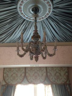 Antique Italian Chandelier on a Ceiling of Rich Blue Silk