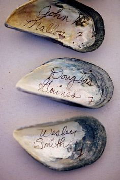 DIY Beach Wedding Inspiration Idea -  Oyster shells that make unusual name or Shell Place Tags for your wedding guests