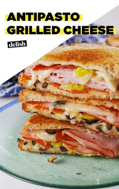 You haven't lived until you've tried Antipasto Grilled Cheese. Get the recipe at Delish.com. #recipe #easyrecipe #cheese #olive #sandwich #pepperoni #mozzarella #grilled #comfortfood #italianfood #easymeals #easydinner #bread #antipasto #ham