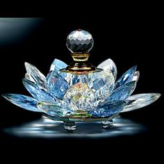 Sparkling blue crystal lotus perfume bottle.