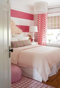striped pink walls with patterned curtains
