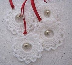 Pretty up your packages with handmade ornaments! Find the pattern for this quick and easy crochet garland ornament at Chalky's World .