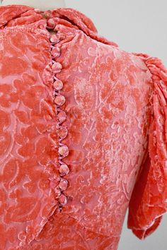 Back detail of 1930s dress showing button and loop technique.