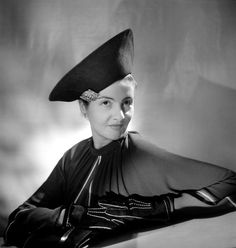 A fashion model wears a felt hat with brooch designed by French fashion designer Jeanne Lanvin, Paris 1930s.