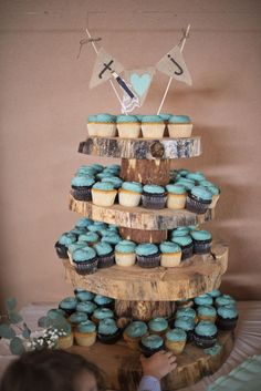 """<strong class='info-row'>Emma Marie Photography</strong> <div class='info-row description'>In lieu of a wedding cake, the couple served blue frosted cupcakes! A cookie buffet was also on offer.    """"My husband and I love cookies and prefer them over cake,"""" Triston says. """"He and my mom made six different types of cookies for the wedding!""""    Cupcakes: Whole Foods</div>"""