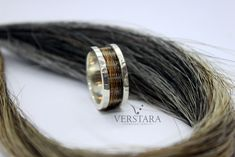 Starting at $475 CAD - ships worldwide! Horsehair jewelry made with your own horse's tail. Custom horse hair ring. Hammered horsehair ring. www.verstara.com Horse Hair Jewelry, Horse Tail, Rugged Look, Hair Rings, Wide Rings, Verse, Jewelry Stores, Rings For Men, Take That