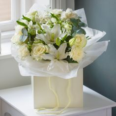 Elegant, This stunning bouquet of white Carema roses, alstroemeria, carnations, lilies and eucalyptus leaves is presented in an elegant cream gift bag. #nextflowers