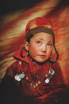 "Afghanistan | Portrait of Susai (6yrs old), Sultan's daughter. Wakhjir valley at the source of the Oxus. | ©Image and caption Matthieu Paley. ""Forgotten on the Roof of the World - Afghanistan's Pamir."