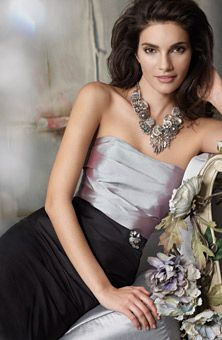 Jim Hjelm Occasions  I love this color scheme.  Look at the big necklace.  Great with silver and black.