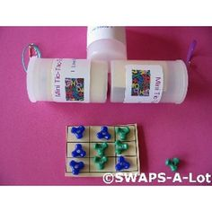 Mini tic tac toe games - make in an old plastic film case or medicine bottle... Cute idea - GREAT stocking stuffers! ~ Mary J