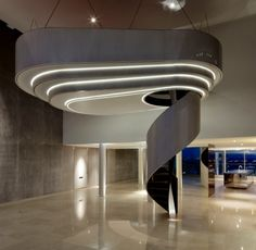 Luxury interior design piece by TINTAB Ltd. Suspended pod with spiral staircase, hand crafted by the team. #designerhome #bespoke #statement #staircase #spiralstaircase #stairs #entertainingguests #dreamhome #interiordesignideas #luxuryinteriors #tintab #interiorarchitecture #architecture #luxuryhome #sculpture #installation