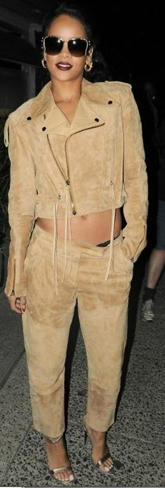 Who made Rihanna's gold sunglasses, suede pants, tan jacket, and gold sandals?