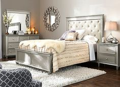 Make your bedroom look glamorous with the Tiffany 4-piece queen bedroom set. Its Hollywood-inspired design is dazzling, from the polished nickel hardware to the crystal-look tufting. The cream-colored, leather-look upholstery is so stylish, plus provides a place to rest your head while reading or watching TV. Faux snakeskin accents adorn the drawer fronts and trim for even more flair, and the entire bedroom set features a stunning silver finish.