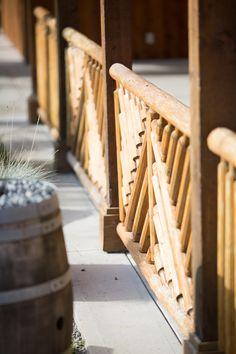 Custom log railing for outdoor patio. | Artisan Log Homes