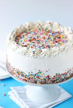 A classic birthday ice cream cake recipe with three layers of ice cream sandwiched between fluffy vanilla cake. A fun and easy celebration cake. #icecreamcake #cake #icecream #aclassictwist Köstliche Desserts, Frozen Desserts, Delicious Desserts, Food Cakes, Cupcake Cakes, Cake Recept, Ice Cream Birthday Cake, Cake Birthday, Circus Birthday