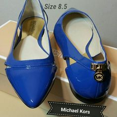 Michael Kors Flats A Michael Kors padlock at the heel adds a flash of signature glamour to a lithe pointy-toe flat fashioned with elegant side cutouts.  Leather upper/leather and synthetic lining/rubber sole.By MICHAEL Michael Kors; imported.Women's Shoes. Michael Kors  Shoes Flats & Loafers